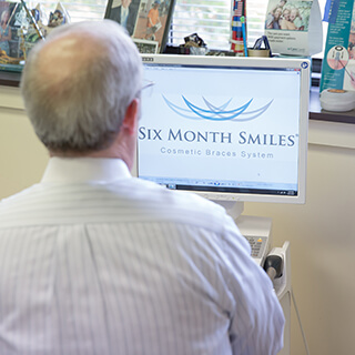 Dr. Mitchell using Six Month Smiles design software