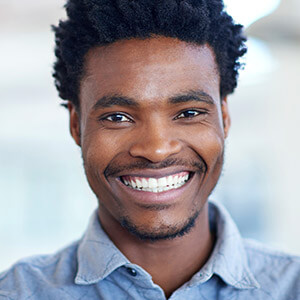 Happy man with bright healthy smile